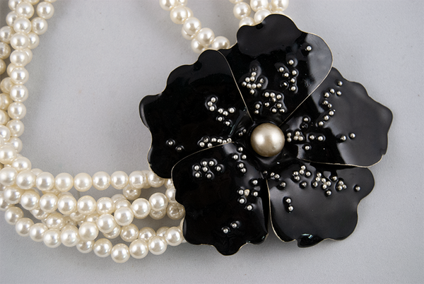 Pearl necklace with black flower (closeup)