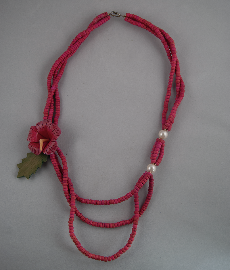 Layered pink beaded necklace with flower