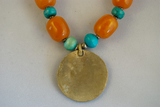 Turquoise, amber, and faux gold pendant necklace