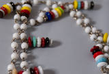 Extra long white beaded necklace