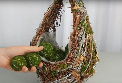 Moss Balls Are Being Put Into the Basket
