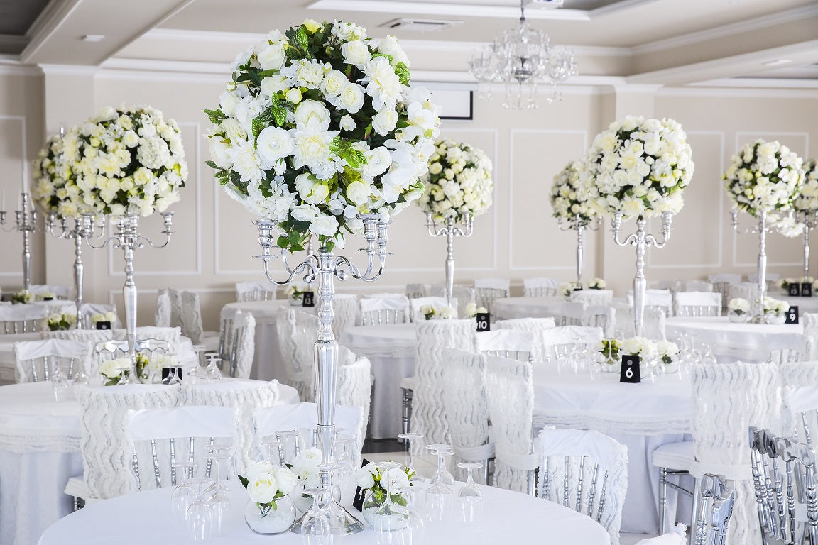 white round tablecloth with candelabra centerpiece