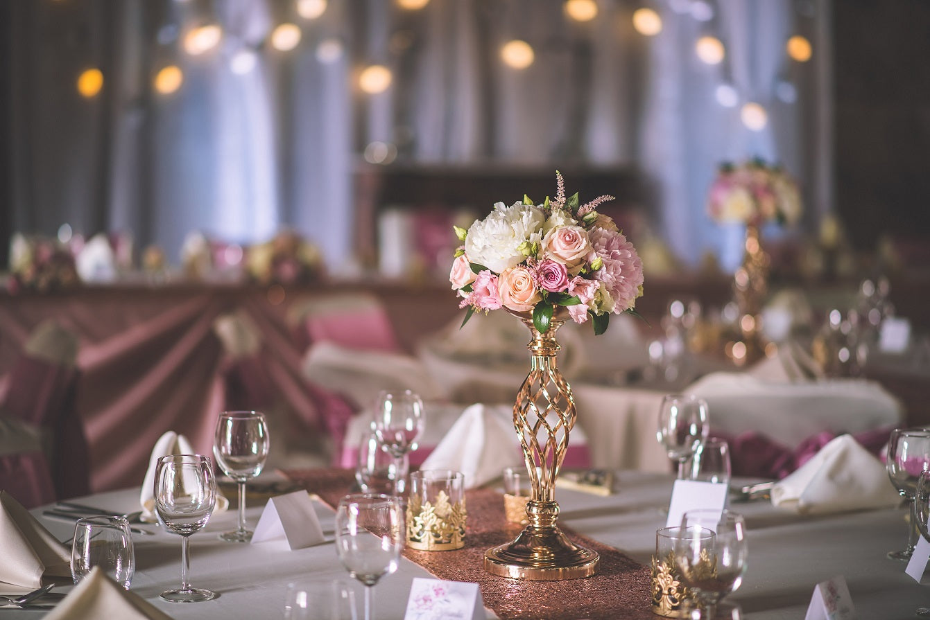white round tablecloth with gold metal centerpiece