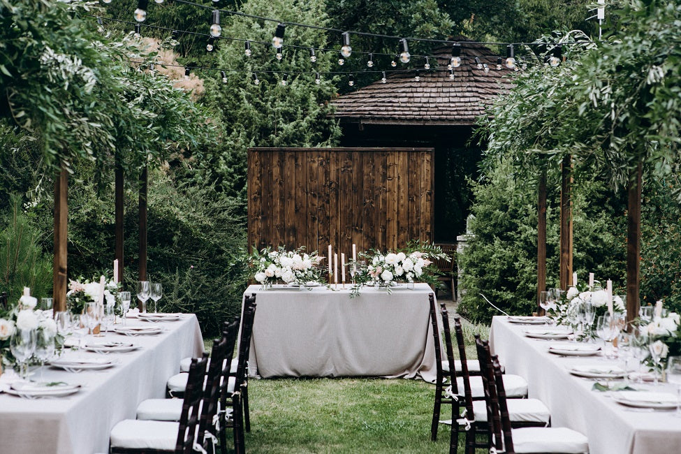 outdoor banquet with white polyester tablecloths