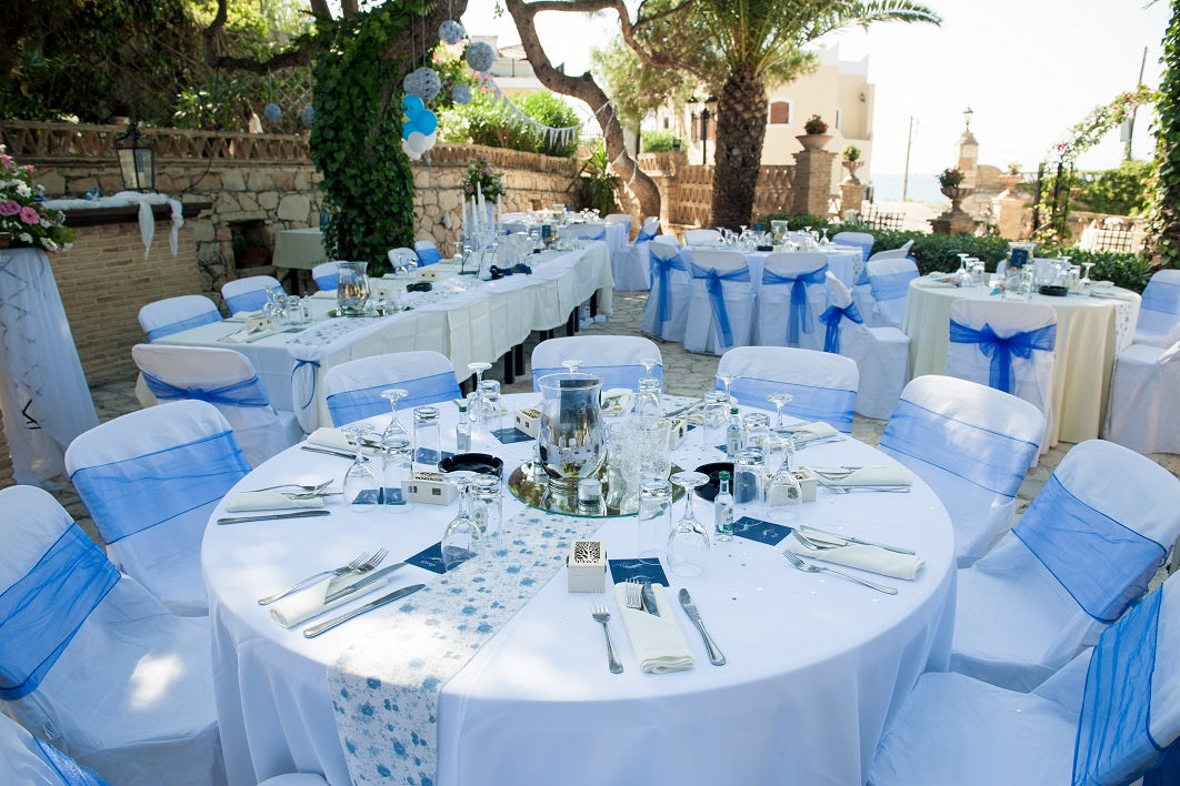 wedding with round tablecloth, chair cover and chair sashes