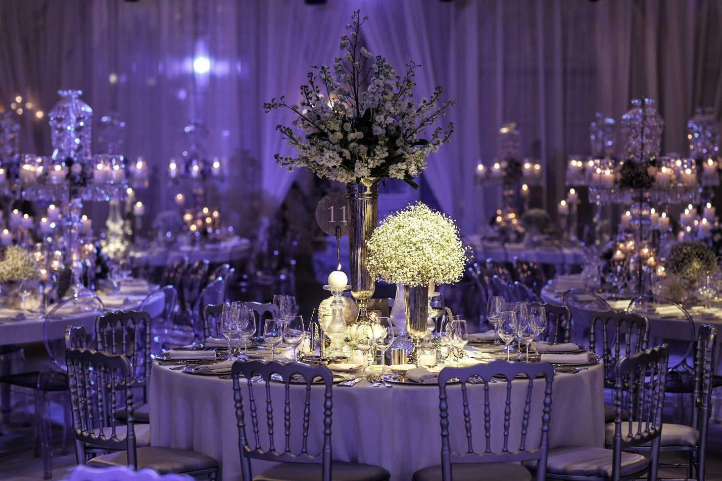 purple themed event with candle centerpieces