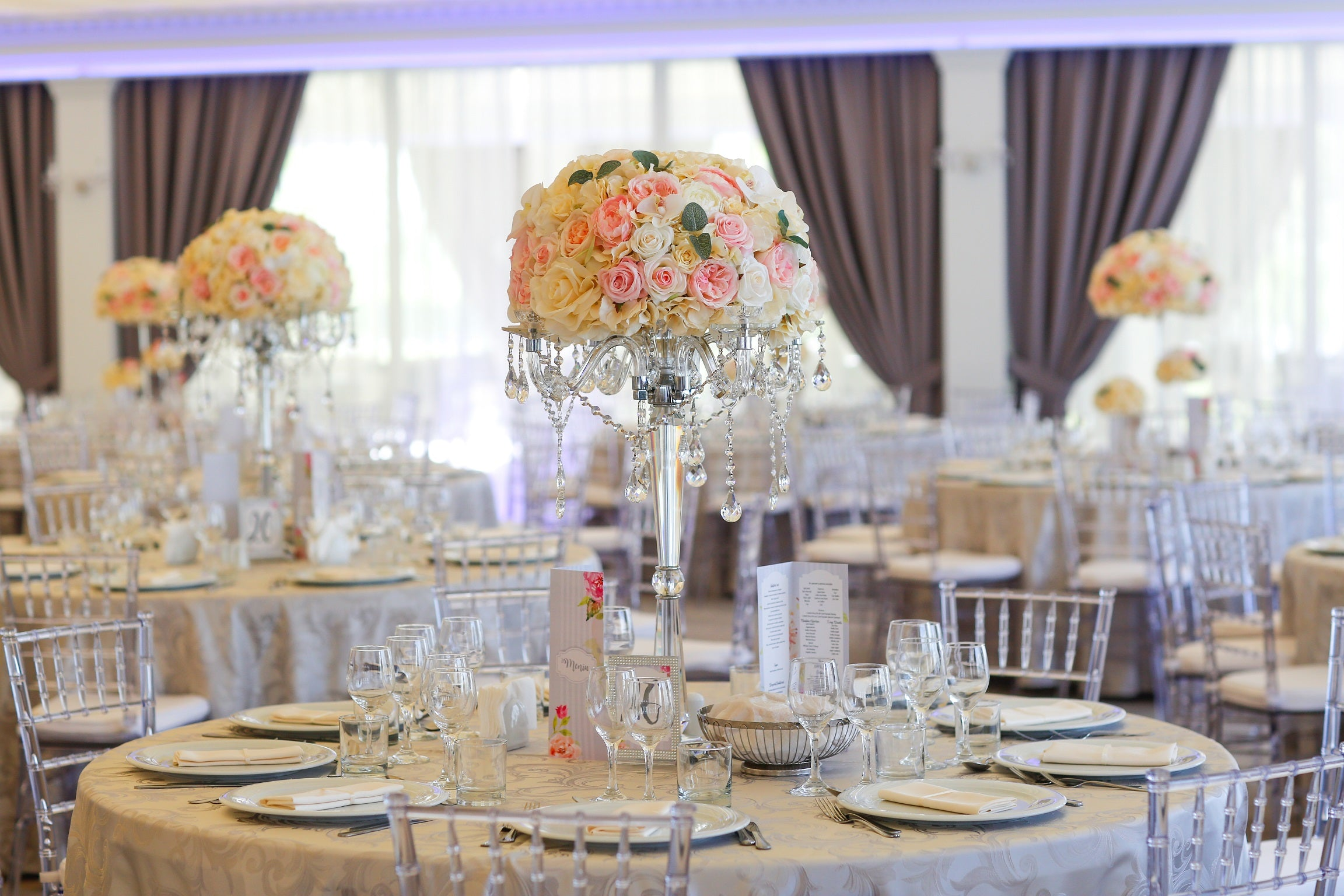 Banquet table with tablecloth and glass flower vase