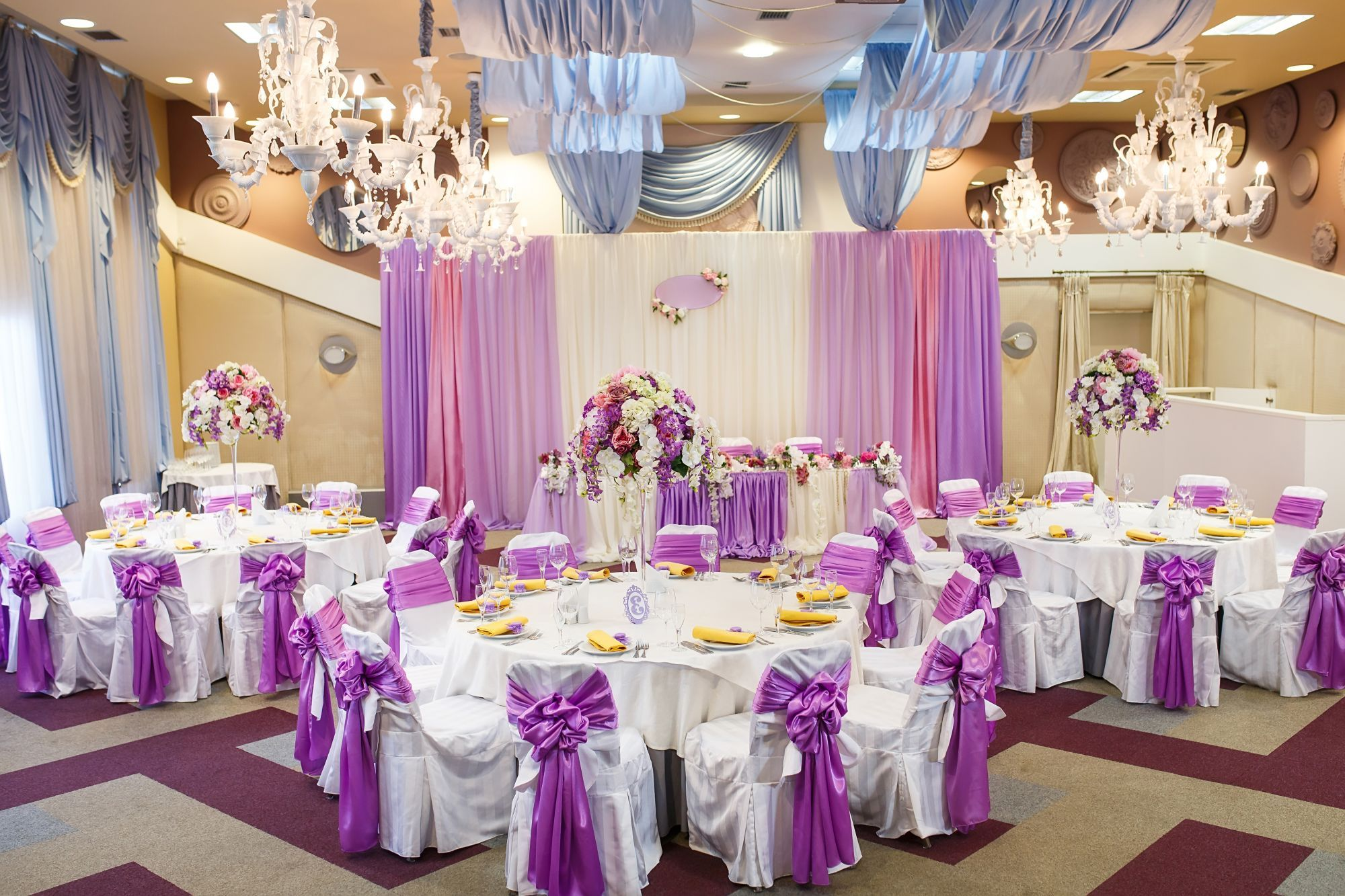 banquet room with chair covers, tablecloths & centerpieces