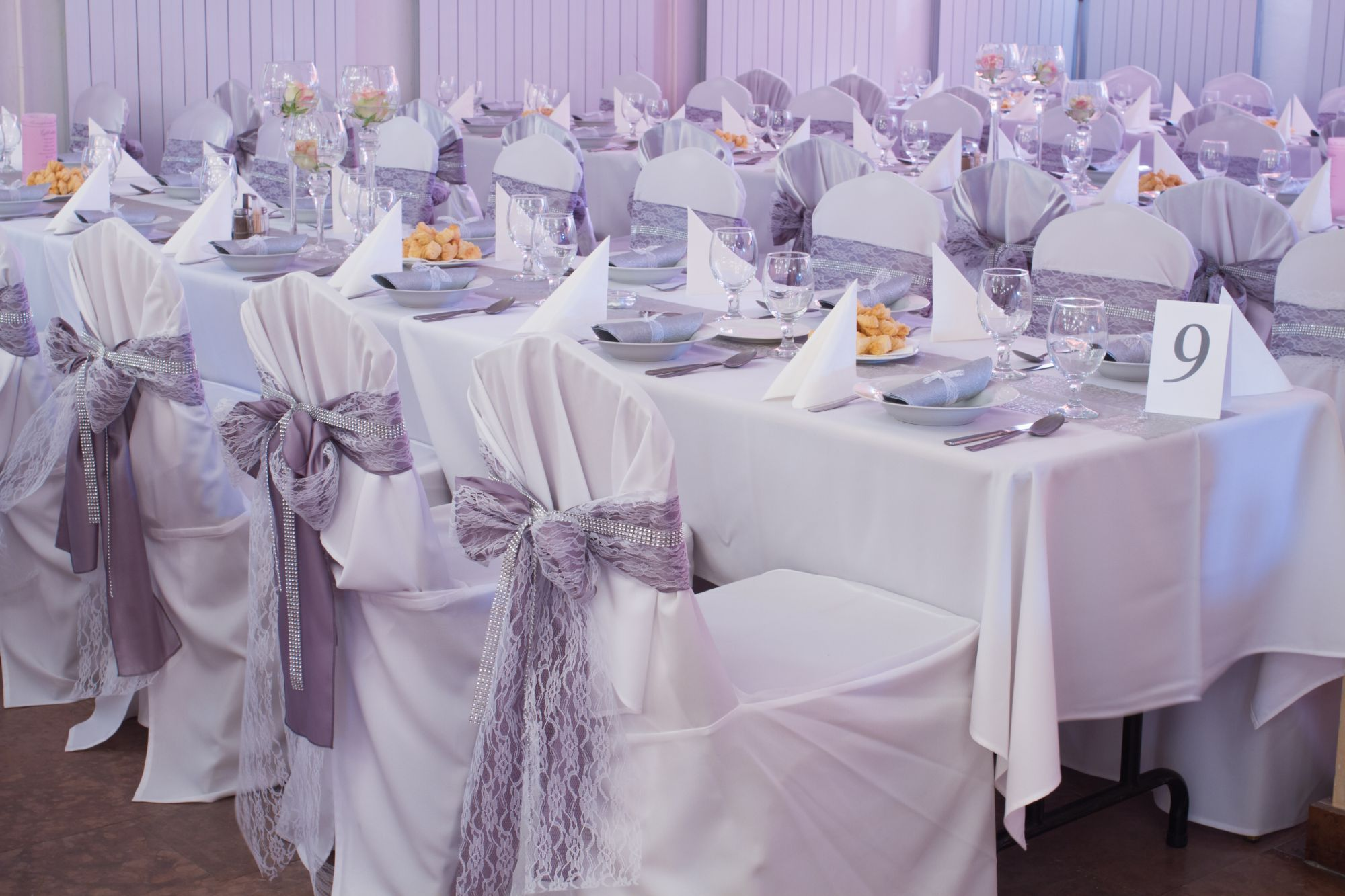 banquet table with tablecloths, chair covers and chair sashes