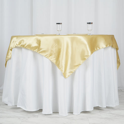 "60""x 60"" Champagne Seamless Satin Square Tablecloth Overlay"