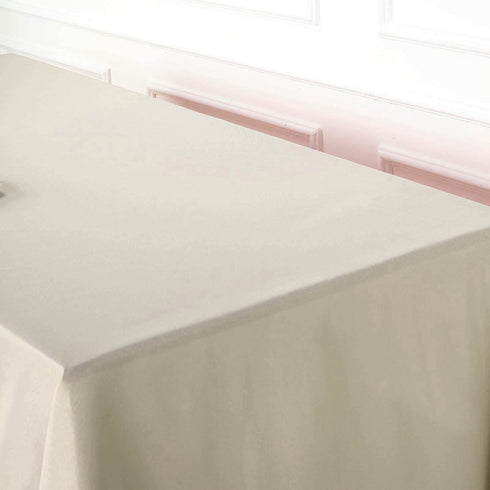 "60""x102"" Beige Polyester Rectangular Tablecloth"