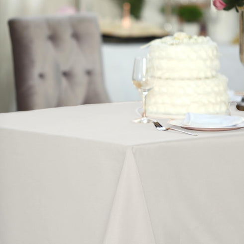"60""x102"" Ivory Polyester Rectangular Tablecloth"