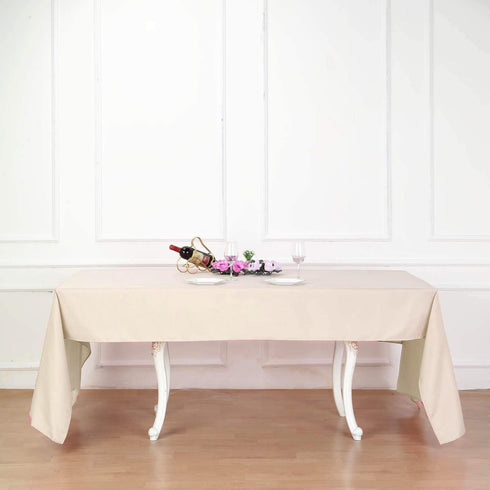"60""x126"" Beige Polyester Rectangular Tablecloth"