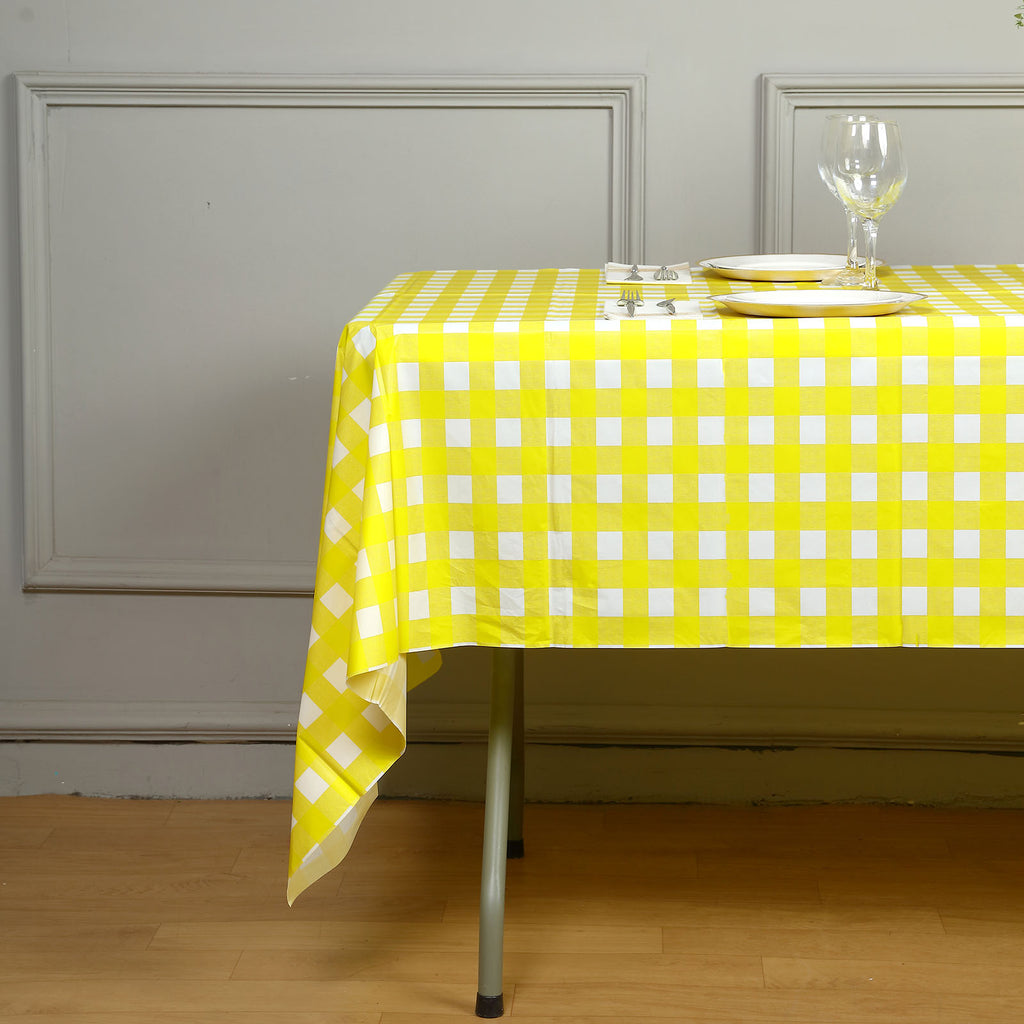 "Gorgeous Checkered 54x108"" Disposable Plastic Table Cover - White / Yellow"