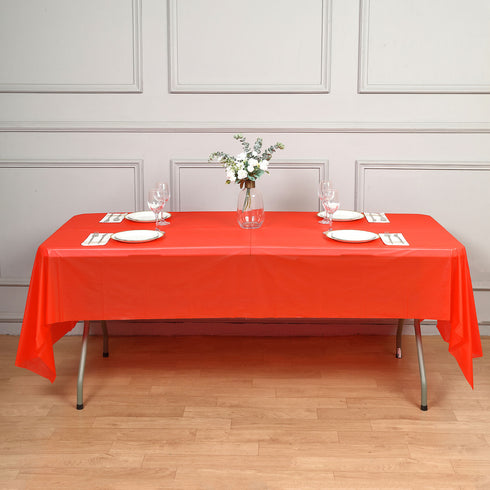 "Spotless Elegance 54x108"" Disposable Plastic Table Cover - Red"