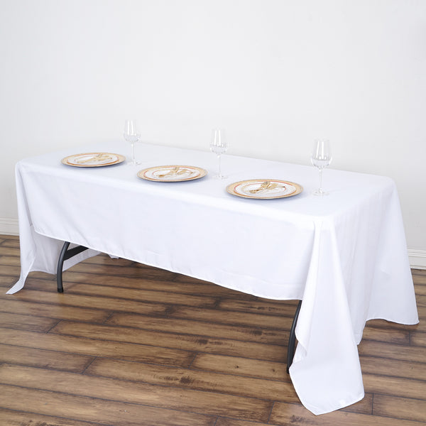 "60""x126"" White Commercial Grade 250 GSM Polyester Rectangle Tablecloth"