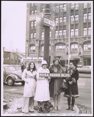 Rosa Parks Holding her Street Sign