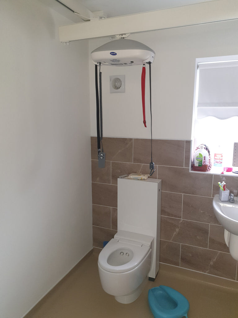 Invacare Robin room to room ceiling hoist X-Y system Liverpool.