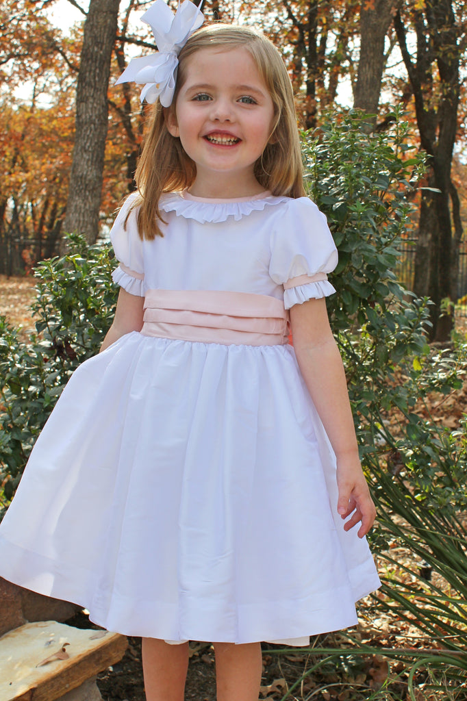 White dress with ruffle collar and sleeve with pink trim