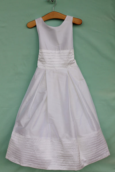 White silk tea length dress with pintuck waist and hem