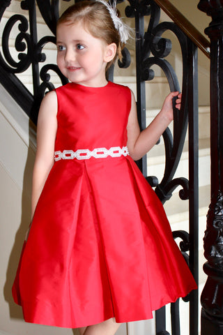Red box pleat dress with trim on waist