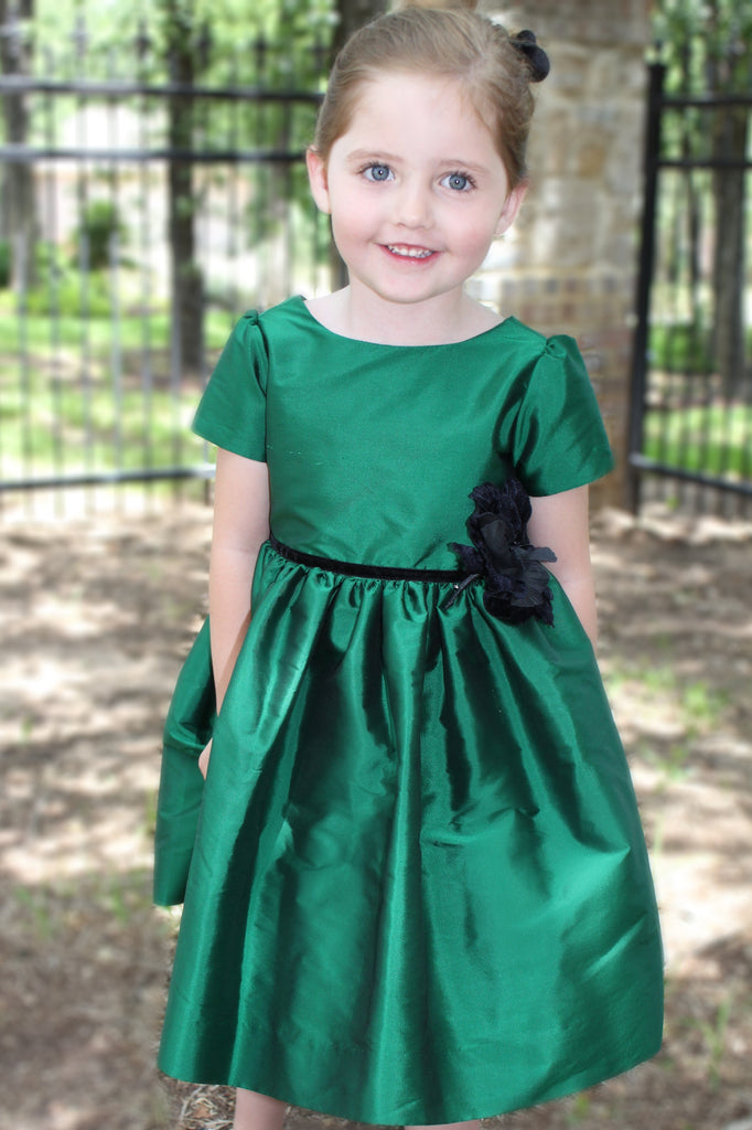 Green dress with velvet ribbon and flower