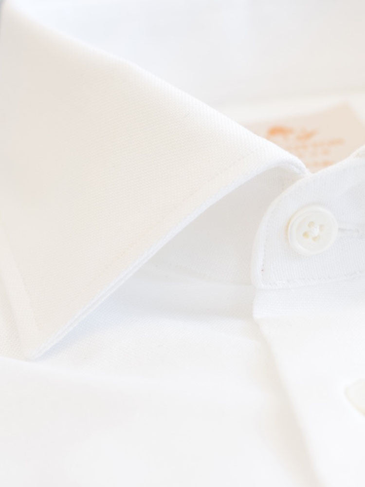 Formal Semi-cutaway collar Luxurious white shirt made with Albini Royal Oxford. Crafted in superfine cotton, slim fitted with semi-cutaway collar, full sleeves & French cuffs, MOP buttons
