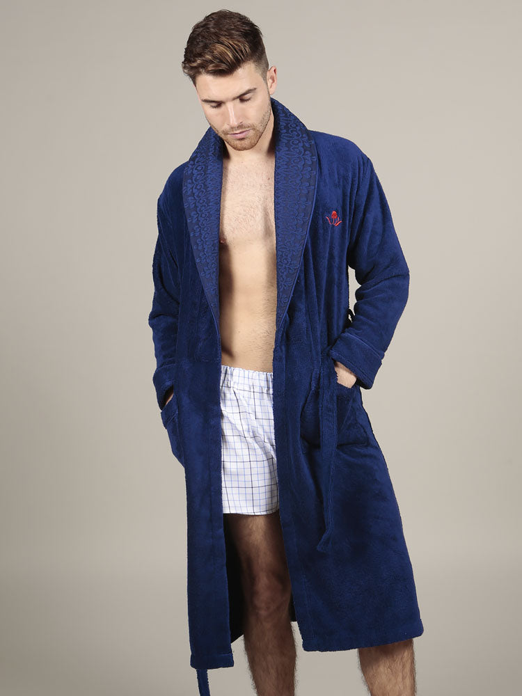 Model wearing luxurious navy cotton bathrobe