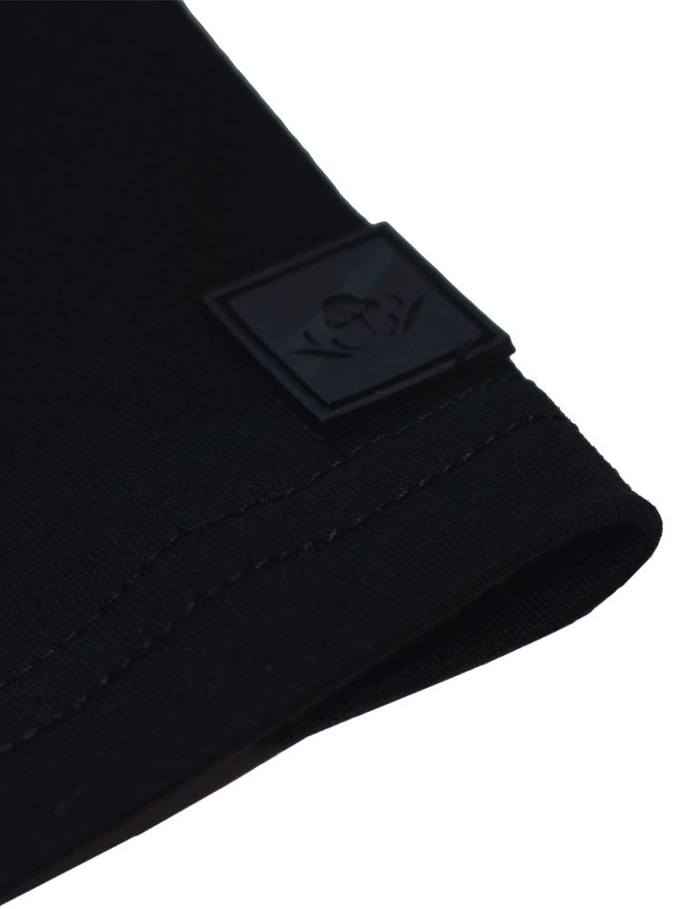 The Cotton® logo tab on front left corner