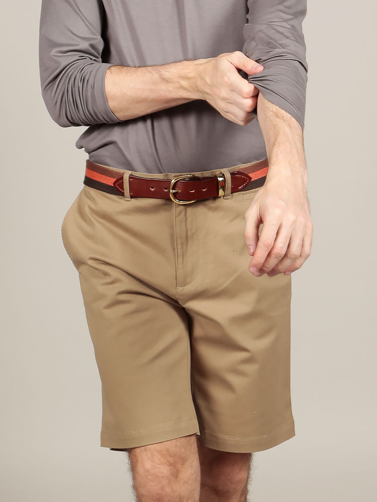 Model wearing canvas belt with chino shorts