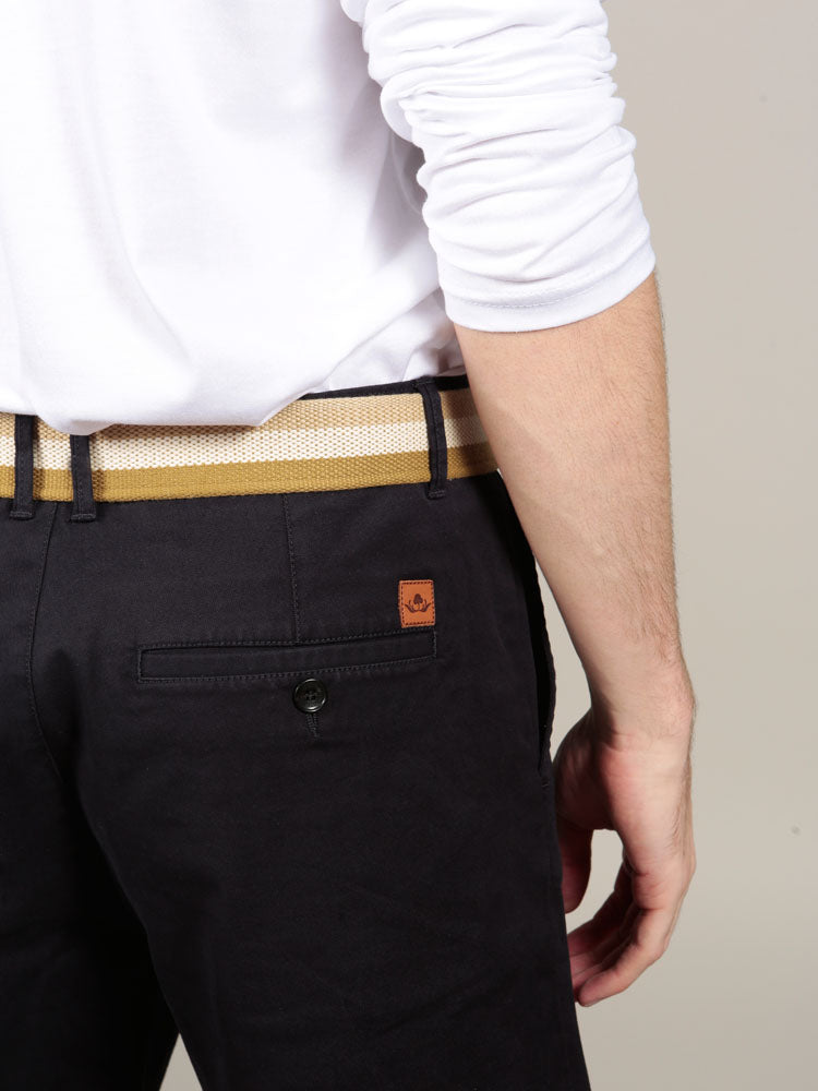 Beige canvas belt with navy chino shorts