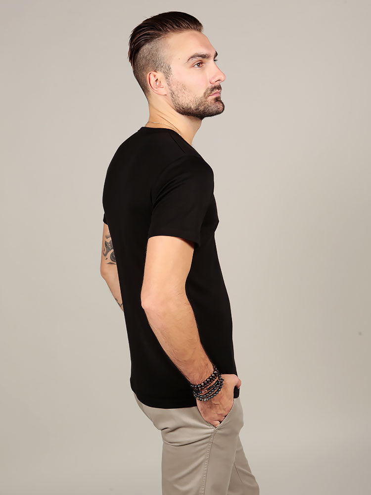 Side view of model wearing Supima cotton t-shirt
