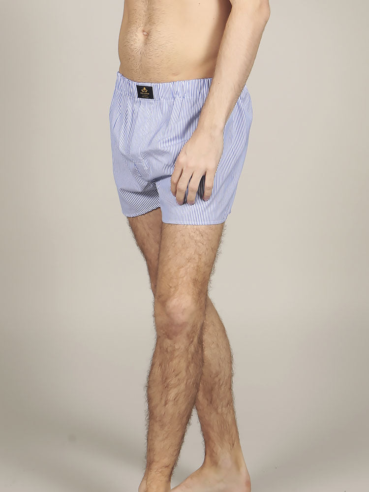 Male model wearing striped cotton boxers in mauve