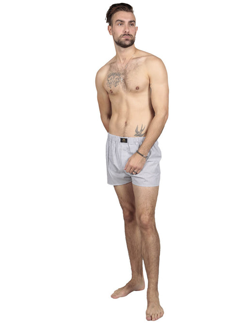 Model wearing striped cotton boxers in grey