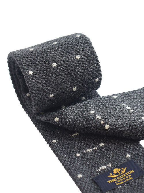 Pindot motif for knitted tie