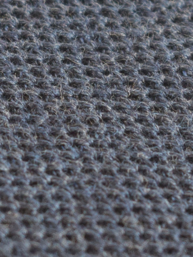 Compact weave for knitted tie