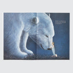 Open book showing a two-page spread of the main character caressing the nose of a giant polar bear.