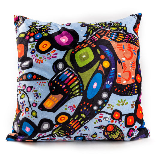 A cushion made of printed fabric featuring colourful artwork depicting a bear.