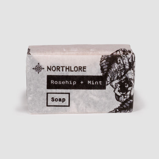 "Front of soap wrapper where we can read ""Northlore,"" ""Rosehip + Mint"" as well as ""Soap""."