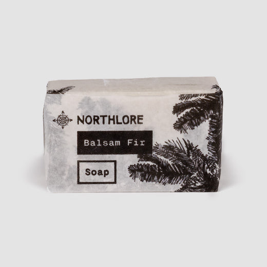 "Front of soap wrapper where we can read ""Northlore,"" ""Balsam Fir"" as well as ""Soap""."