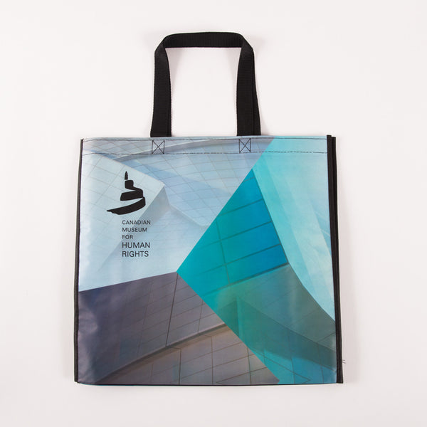 "Tote bag featuring the Museum and the text ""CANADIAN MUSEUM FOR HUMAN RIGHTS"""