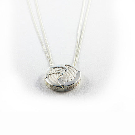 Circular pendant made up of two silver wings; each wing hangs from its own chain