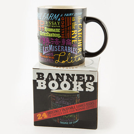 mug on top of a box featuring several titles of banned books
