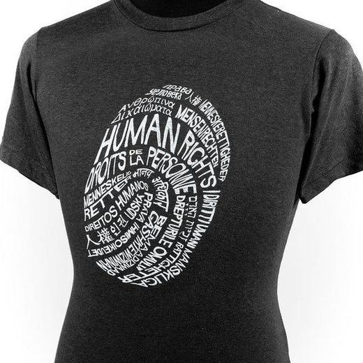 "Black crew-neck T-shirt with the text ""human rights"" in several different languages; shown on a male bust form."