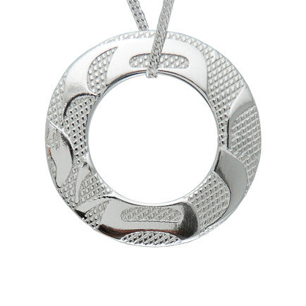 silver-pewter ring-shaped pendant on a silver chain