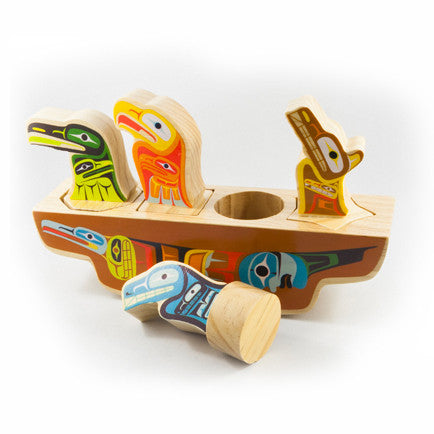 5-piece painted wooden toy with a whale, a wolf, a raven and an eagle sitting in a canoe
