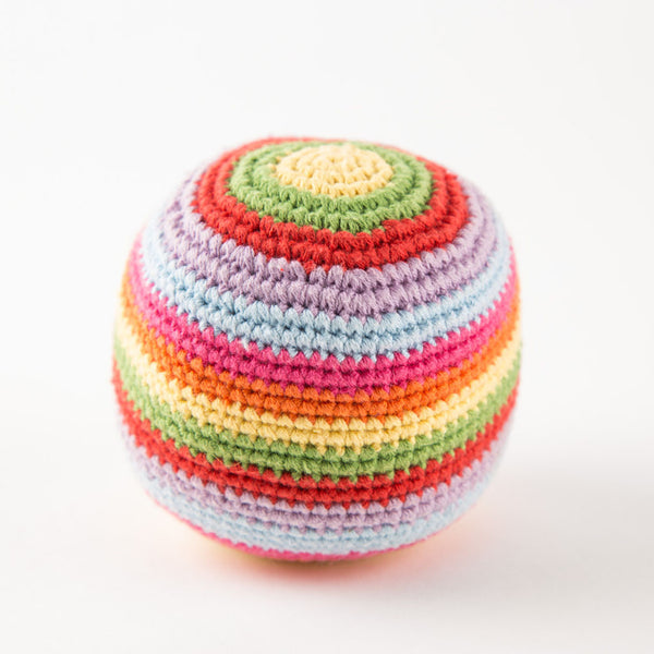 a rainbow-coloured baby rattle in the shape of a ball