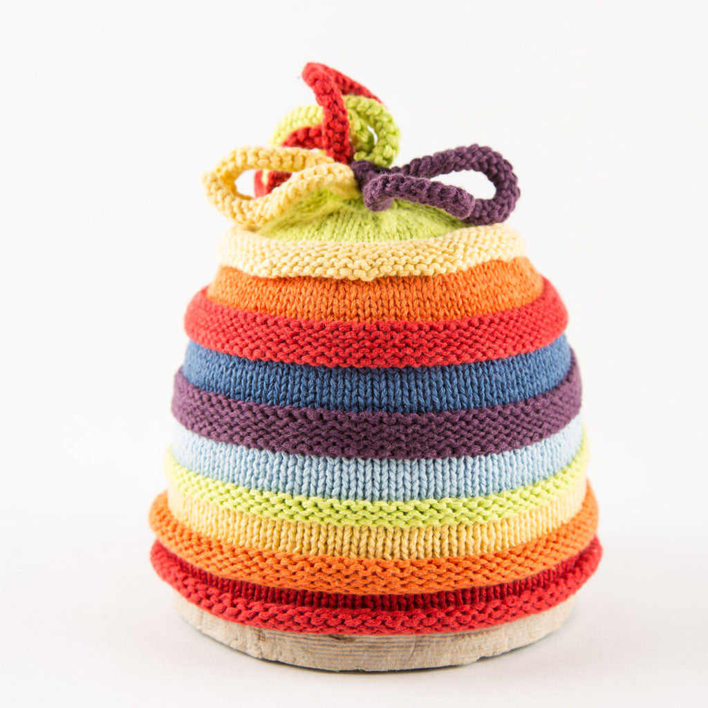 a rainbow-stripped knitted baby hat