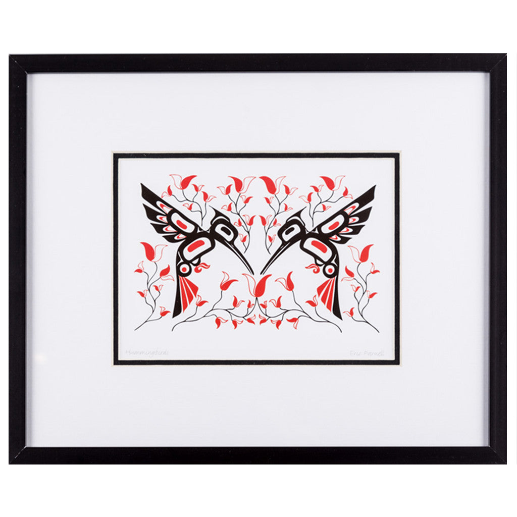 a framed art print featuring two hummingbirds surrounded by flowers