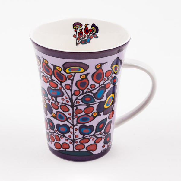 porcelain mug with a floral design; a small floral design is on the interior of the mug and near the rim